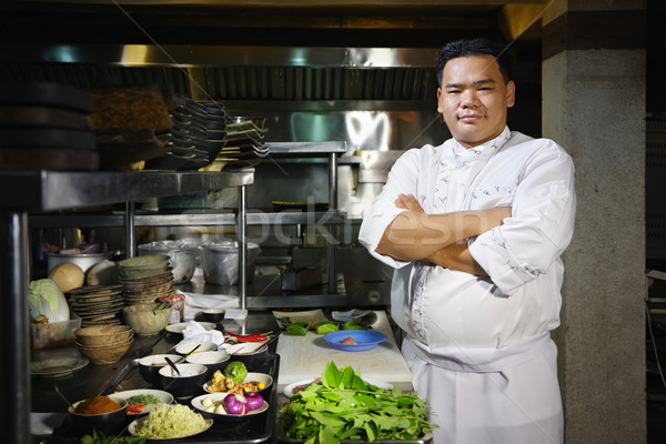 asian chef smiling at camera in restaurant kitchen Stock photo © diego_cervo