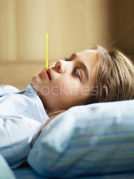 Doente menina temperatura cama cópia espaço Foto stock © diego_cervo