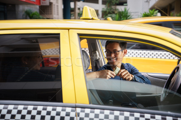 taxi driver driving car happy client paying money Stock photo © diego_cervo