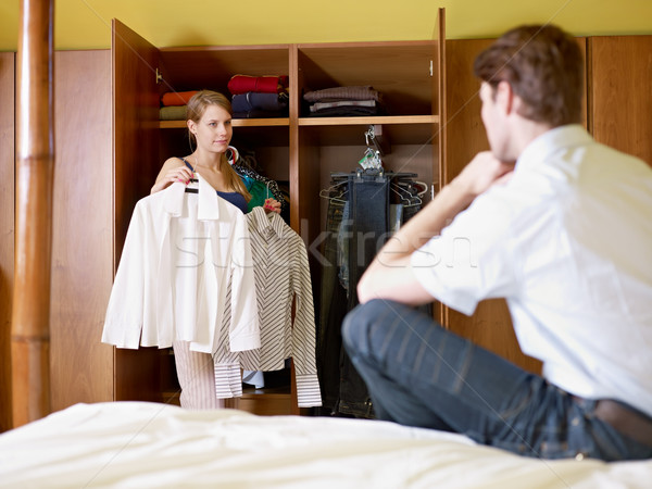 Stock photo: young couple getting dressed