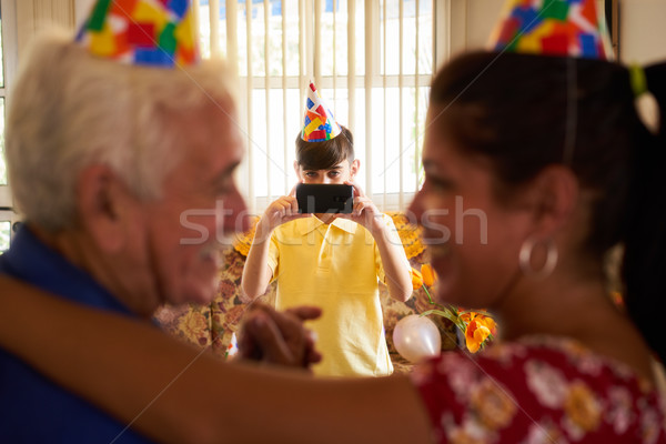 Child Taking Photo Of Happy Mom And Grandpa Dancing Stock photo © diego_cervo