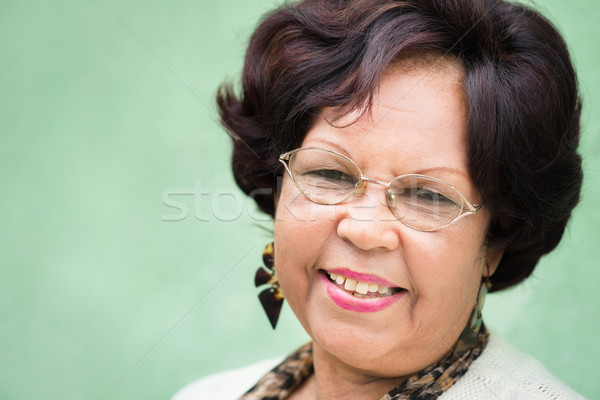 Portrait of happy elderly black lady with eyeglasses smiling Stock photo © diego_cervo
