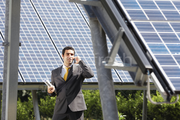 businessman and solar panels Stock photo © diego_cervo