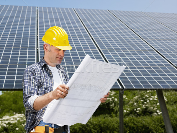 electrician standing near solar panels Stock photo © diego_cervo