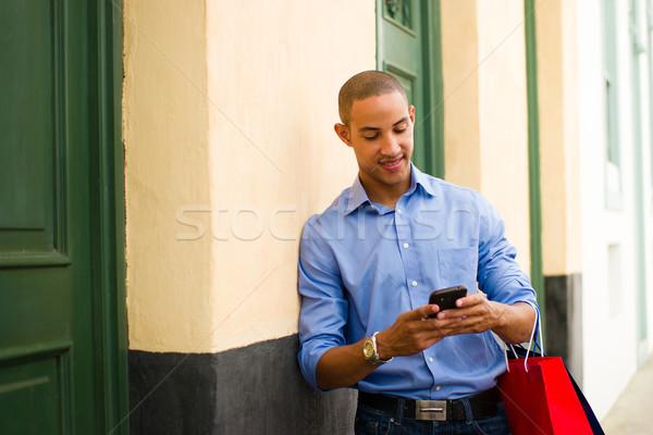ストックフォト: アフリカ系アメリカ人 · 男 · ショッピング · 電話 · 黒人男性