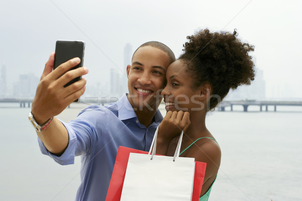 African American Couple Shopping Taking Selfie With Mobile Phone Stock photo © diego_cervo