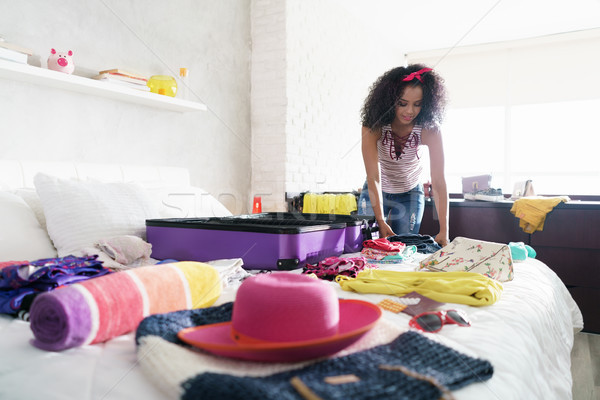 Pretty Young Black Woman Packing Bags For Holidays Stock photo © diego_cervo