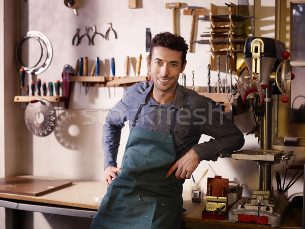 Happy italian artisan at work, smiling in guitar workshop Stock photo © diego_cervo