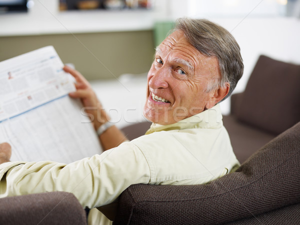 Stock photo: senior man reading newspaper