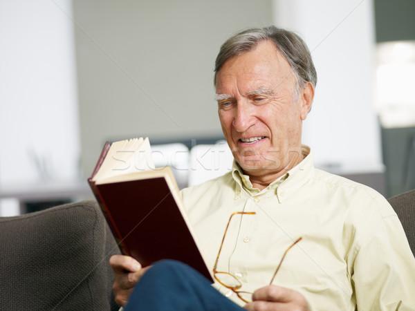 Kıdemli adam okuma kitap ev bo Stok fotoğraf © diego_cervo