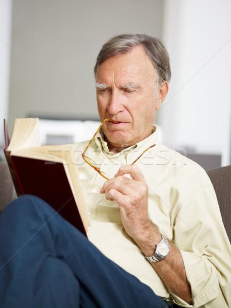 senior man reading book Stock photo © diego_cervo