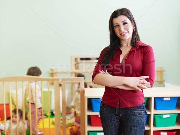 female teacher looking at camera Stock photo © diego_cervo
