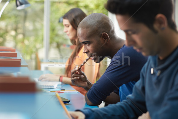 student eating chocolate bar in library Stock photo © diego_cervo