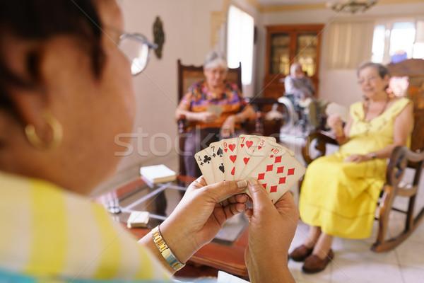 öreg nők jókedv játszik kártya játék Stock fotó © diego_cervo