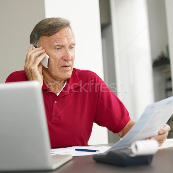 Senior man checking home finances Stock photo © diego_cervo
