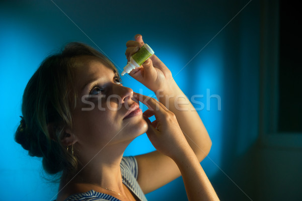 Woman With Eyes Tired Applying Collyrium Eye Drops Stock photo © diego_cervo