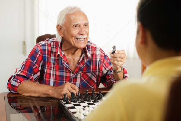 Grandpa Playing Chess Board Game With Grandson At Home Stock photo © diego_cervo