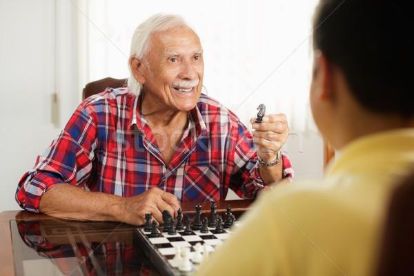 Nagypapa játszik sakktábla játék unoka otthon Stock fotó © diego_cervo