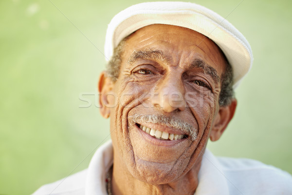 aged latino man smiling at camera Stock photo © diego_cervo