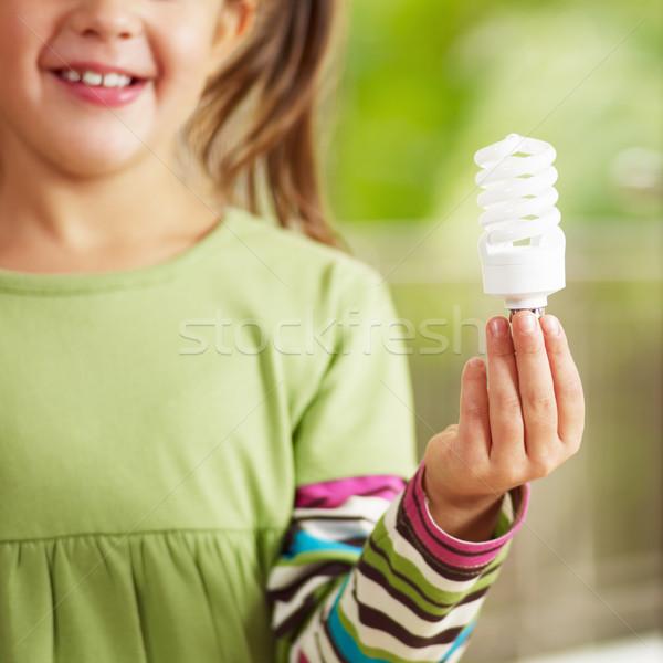 少女 電球 笑みを浮かべて 選択フォーカス 手 ストックフォト © diego_cervo