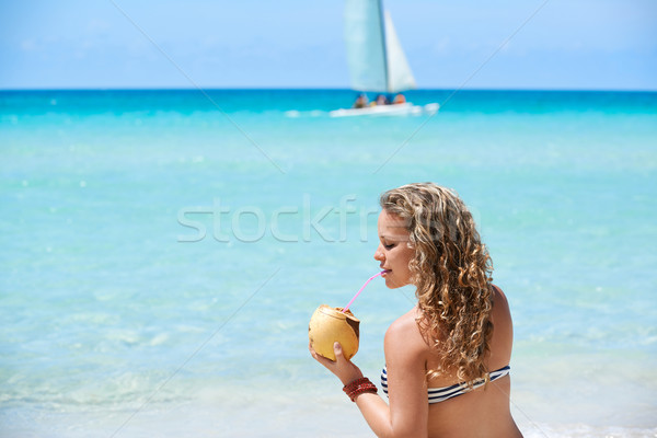 Portrait of woman relaxing with cocktail at cuban beach Stock photo © diego_cervo