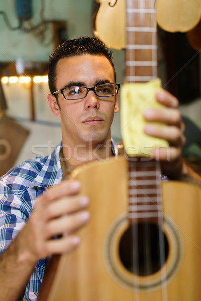 Artisan Lute Maker Cleaning Stringed Music Instrument In Shop Stock photo © diego_cervo