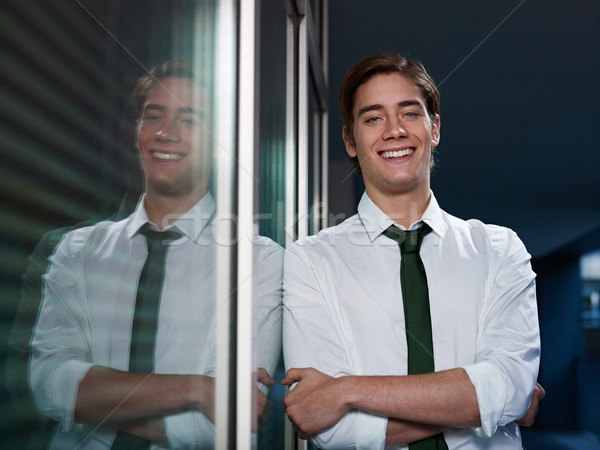 businessman with arms crossed smiling at camera Stock photo © diego_cervo