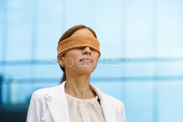 Blindfolded hispanic business woman near office building Stock photo © diego_cervo