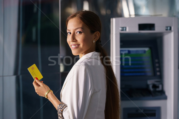 Portrait business woman withdraw cash machine card Stock photo © diego_cervo