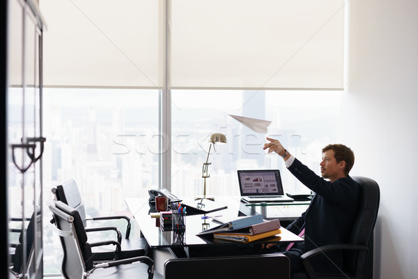 Successful Man Office Worker Daydreaming Throwing Paper Airplane Stock photo © diego_cervo