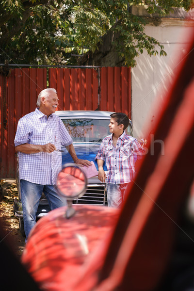 Grandfather Teaching Vintage Car And Engine To Grandson Stock photo © diego_cervo