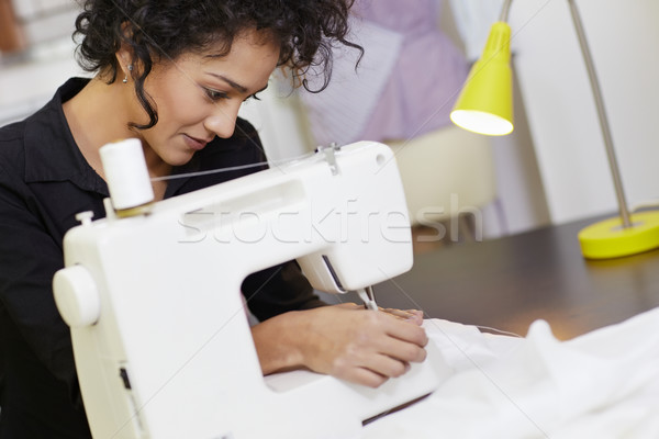 Fashion designer with sewing machine Stock photo © diego_cervo
