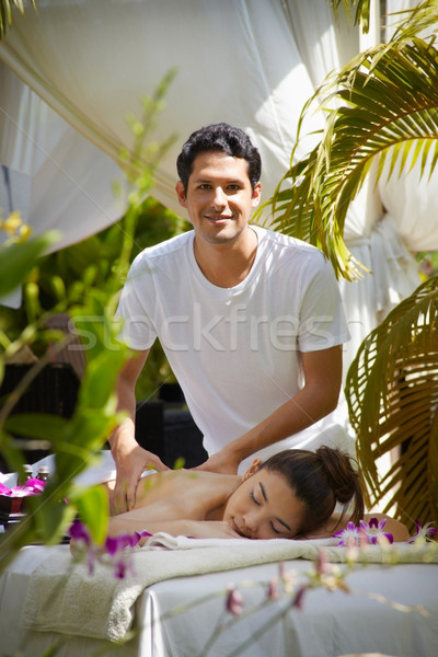 Masseur at work massaging woman in luxury spa Stock photo © diego_cervo