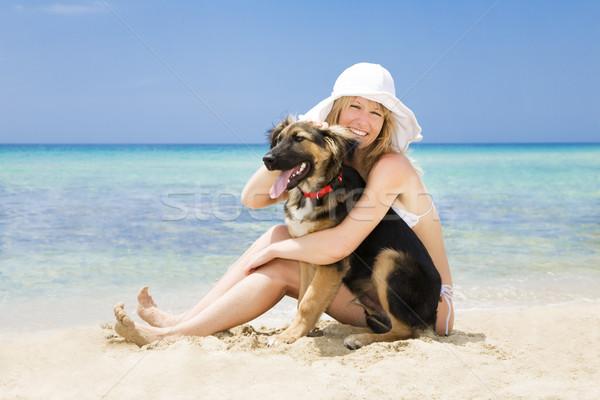 Kutya nő ül homok fekete szeretet Stock fotó © diego_cervo