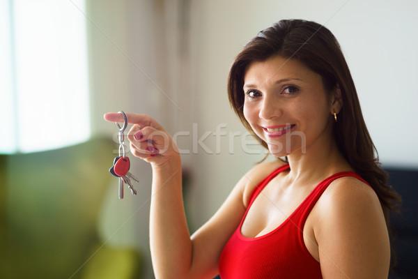Portré nő otthon tulajdonos mosolyog tart Stock fotó © diego_cervo