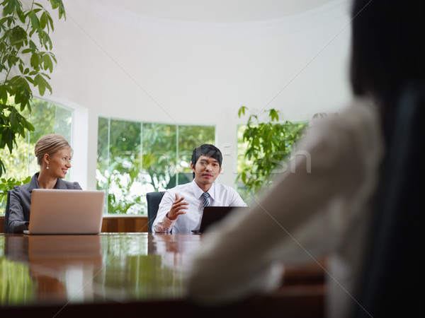 business man and woman talking in meeting room  Stock photo © diego_cervo