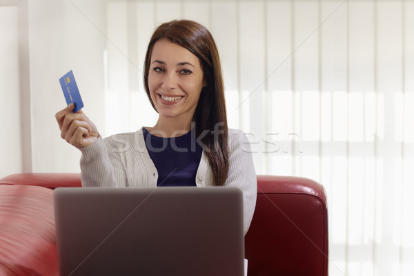 woman with laptop and credit card shopping on internet Stock photo © diego_cervo