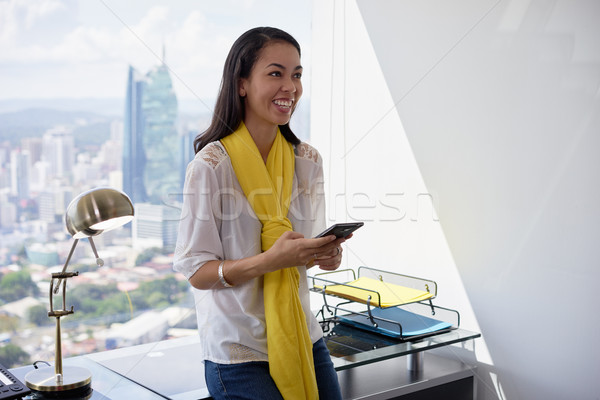 Latina Business Woman Text Messaging On Phone Smiling Stock photo © diego_cervo