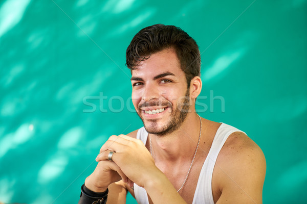 Portrait Happy Young Latino Man With Beard Smiling Stock photo © diego_cervo