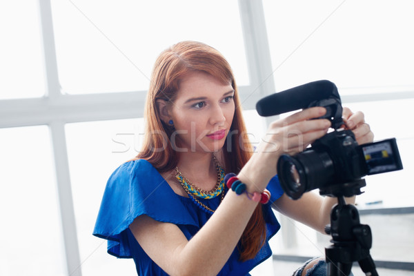 Woman Recording Vlog Video Blog Using DSLR Camera Stock photo © diego_cervo
