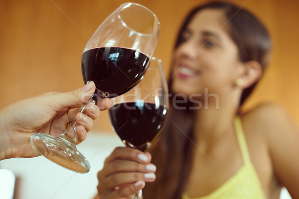 Nők ünnepel otthon pirítós vörösbor kettő Stock fotó © diego_cervo