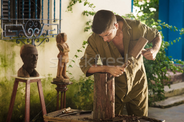 Young Sculptor Artist Working And Sculpting Wood Statue-2 Stock photo © diego_cervo