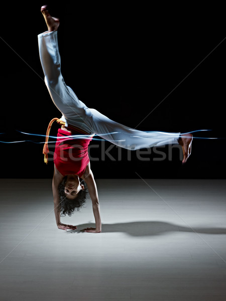 hispanic woman doing capoeira martial art Stock photo © diego_cervo