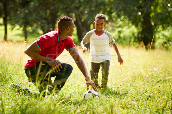 Sport Practice With Father Teaching Son How To Play Soccer Stock photo © diego_cervo