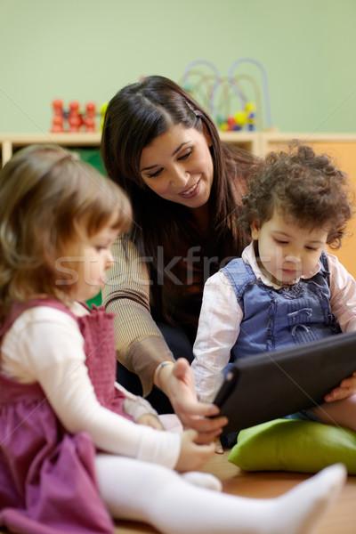 Maestro lectura cuento de hadas ninos escuela caucásico Foto stock © diego_cervo