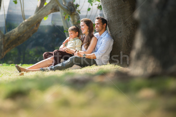 Stock photo: Happy family in city gardens relaxing during holidays