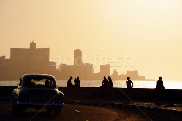 People and skyline of La Habana, Cuba, at sunset Stock photo © diego_cervo