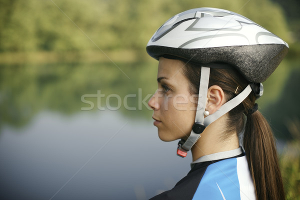 young woman training on mountain bike and cycling in park Stock photo © diego_cervo