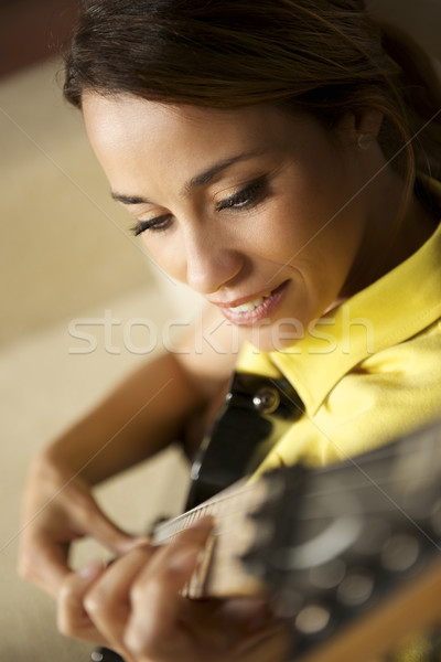 woman playing and training with electric guitar at home Stock photo © diego_cervo