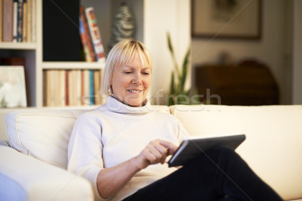 Stock photo: senior woman using touch pad device